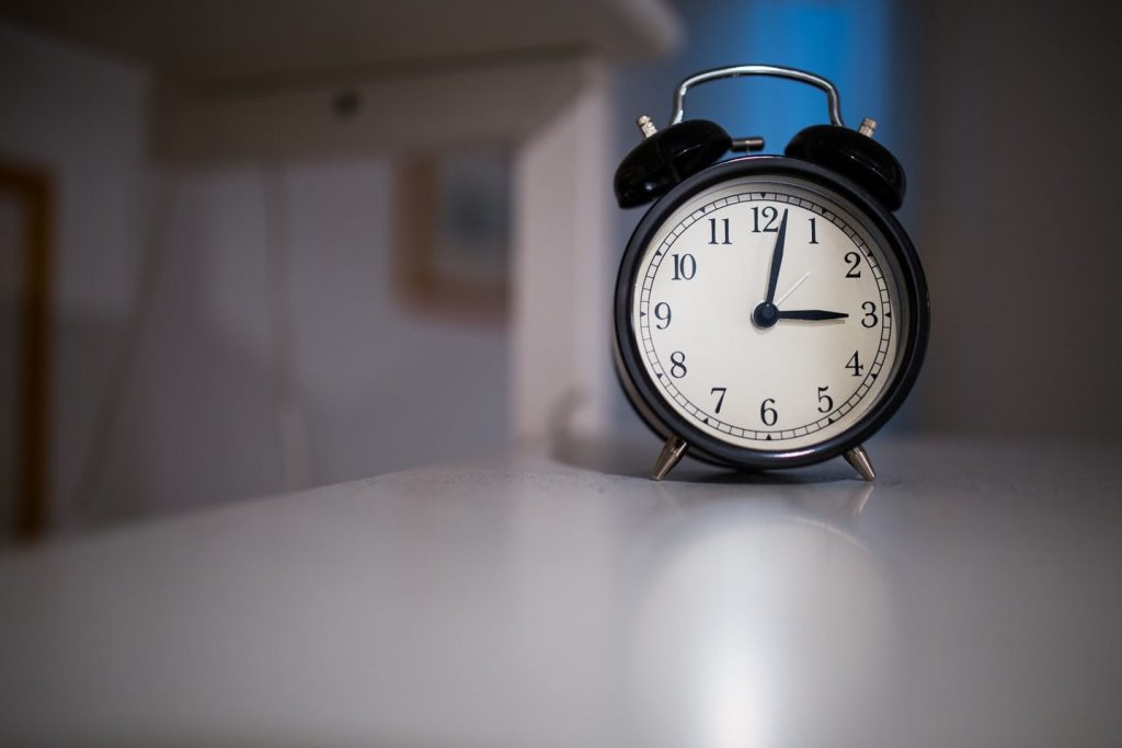 Put the alarm clock away from your reach so that you have to get up for it each morning.